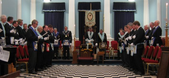 """From Labour to Refreshment"": Members of Copthorne Lodge and their guests from other Surrey Lodges and from visiting French Lodges sing the ""Closing Ode"" at the conclusion of a meeting."